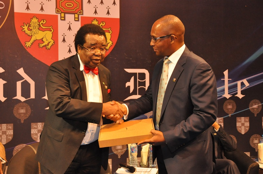 13. Prof. Bolaji Akinyemi being presented with a gift by President of The Oxbridge Club of Nigeria, Mr Akinfela Akoni after the Oxbridge Debate.